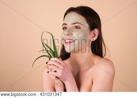 Beautiful Woman With Aloe Vera Facial Procedure, Spa Health Concept. Skin Care Beauty Treatment. Tow