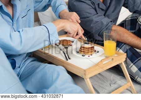 Partial View Of Gay Couple Having Breakfast In Bed