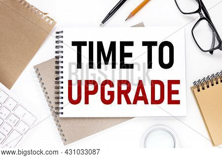 Time To Upgrade, Text On Notepad On White Background