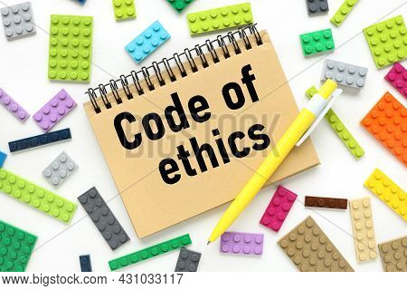 Code Of Ethics, Text On A Craft Notebook Near The Constructor Of Different Colors
