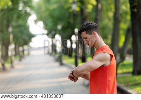 Sportsman Check Time On Wristlet Watch During Outdoor Athletic Training In Park, Sports Timing