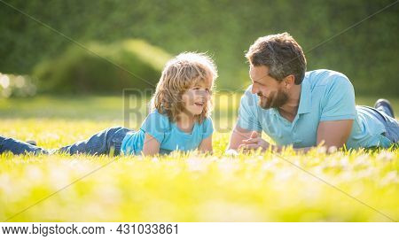 Parenting And Fatherhood. Fathers Day. Happy Cheerful Father And Son Having Fun In Park