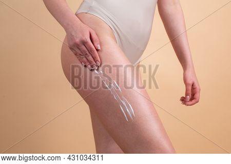 Body Care. Woman Applying Cream On Legs. Female Applying Anti Cellulite Cream. Cellulite Or Anti Cel