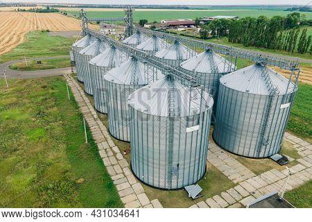 Grain Storage Elevator, Large Metal Hangar For Grain. Silo With Grain Aerial View