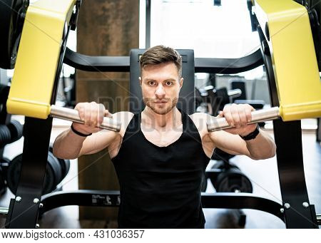Muscular Handsome Man Working Out In The Gym. Bodybuilding Male Hard Training.