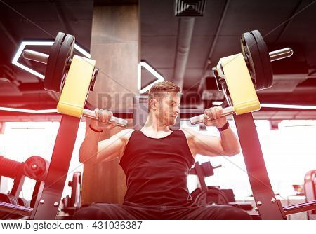Bodybuilding Muscle Man Working Out. Strong Sporty Man Training Hard In The Gym.