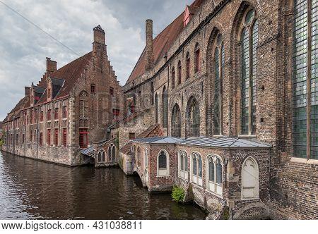 Brugge, Flanders, Belgium - August 4, 2021: Brown Brick Stone Side Facades Of Old Sint Jans Hospital
