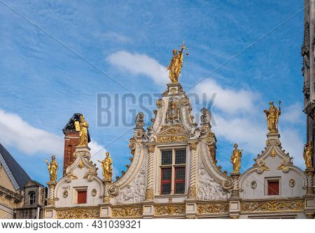 Brugge, Flanders, Belgium - August 6, 2021: Closeup Of Top Of Facade Of Historic Justice Palace On B