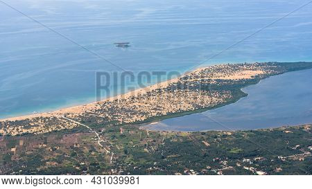 Aerial View Of Sandy Southern Coast Of Corfu Island With Part Of Korission Lake