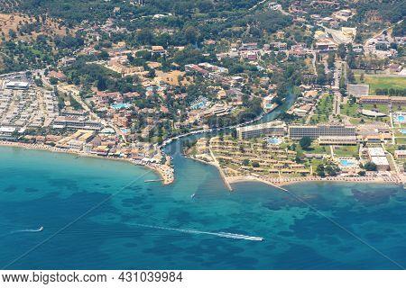 Aerial View Of Tourist Resorts On Corfu Island, Popular Summer Tourist Destination In Europe