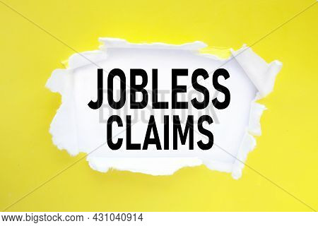 Jobless Claims, Text On Torn Paper. Test In Black Letters