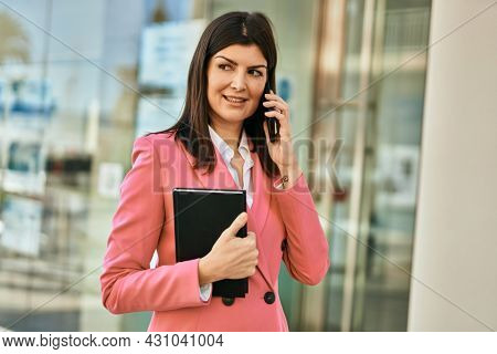 Middle age business woman working as real estate agent. Sales woman using smartphone