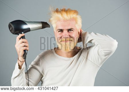 Blonde Bearded Man Hair Dry. Handsome Man With Long Hair Dries His Hair With A Hairdryer.
