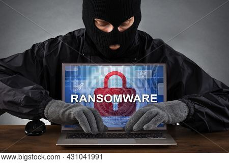 Ransomware Virus. Ransom Extortion Attack. Hacked Encrypted Laptop