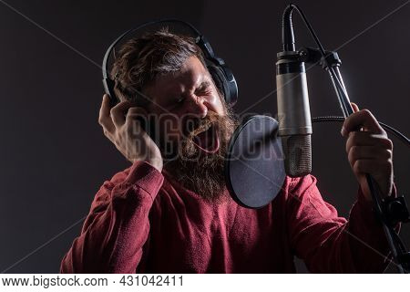 Man With Microphone Singing Song. Musician In Music Hall. Funny Guy Singing In Karaoke.