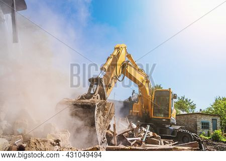 Excavator Breaks Old House, Many Dust In Air. Building Demolition And Deconstruction, Copy Space.