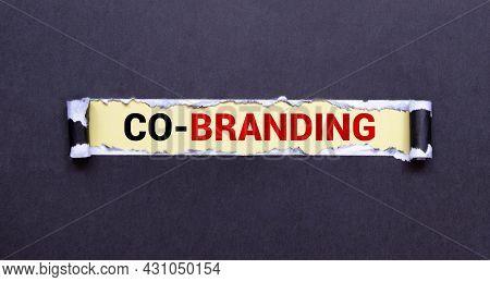 Business Still Life. Co-branding Inscription On Torn Black Paper