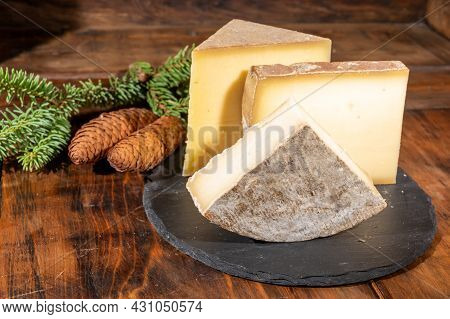 Cheese Collection, French Cow Cheese Comte, Beaufort, Abondance, Tomme De Savoie And Fir Cones