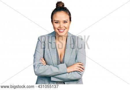 Young hispanic girl wearing business clothes smiling with a happy and cool smile on face. showing teeth.