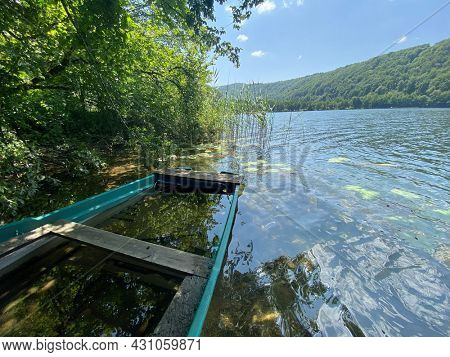wooden small boat abandoned in the  lake water, Lac du Val
