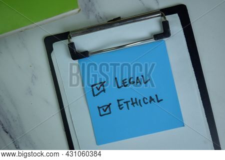 Legal And Ethical Write On Sticky Notes. Supported By An Additional Services Isolated On Wooden Tabl