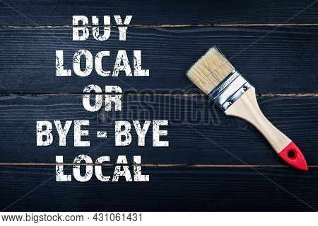 Buy Local Or Bye - Bye Local. Paint Brush On A Black Wooden Surface