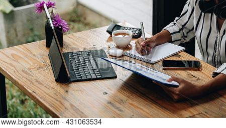 Shot Of Female Accounting Bookkeeper Providing Accounting Service For Small Businesses, Woman Using