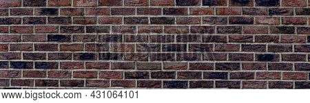 Panoramic Background Of Wide Old Dark Red Brick Wall Texture. Brown Panoramic Background