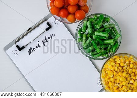 Meal Plan. Three Bowls Of Frozen Vegetables Food Of Yellow Corn, Green Beans, Red Tomatoes. Colors O