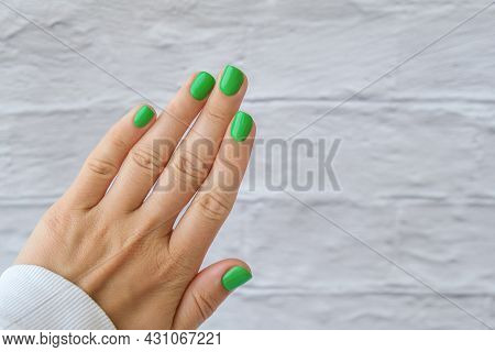 Manicured Female Hands With Stylish Green Nails. Trendy Modern Design Manicure. Gel Nails. Skin Care