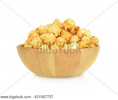 Popcorn In Wooden Bowl Isolated On White Background