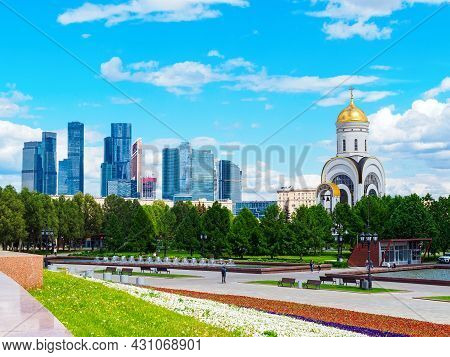 Moscow, Russia - May 24, 2021: View Of The Moscow City And The Temple Of St. George To The Poklonnay
