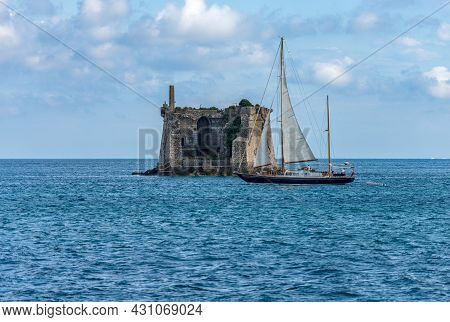 The Ancient Scola Tower (torre Scola) Or Of Saint John Baptist, Xvii Century, And A Sailing Boat In