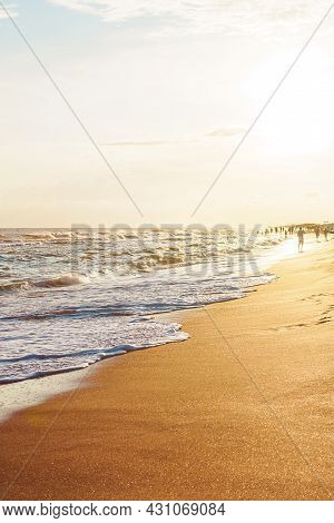 Waves On The Seaside In The Rays Of The Evening Sun