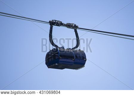 Two Cabins Met On A Cable Car Against The Sky.