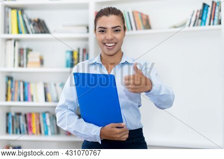 Successful Hispanic Female Business Trainee At Office Of Company