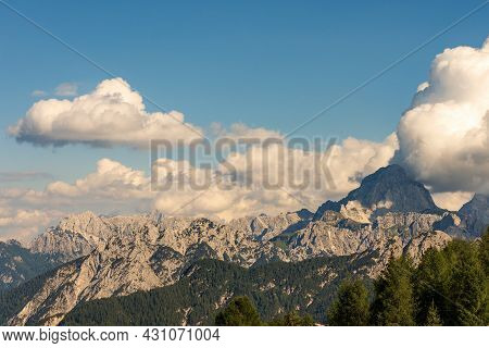 Mountain Range And The Peak Of The Mount Mangart (2677 M.) Seen From The Small Village Of Lussari, J