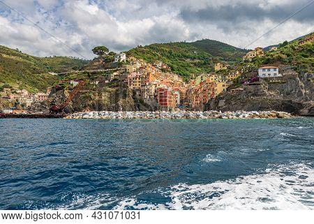 The Famous Riomaggiore Village Seen From The Ligurian Sea, Tourist Resort On The Cinque Terre Coast,