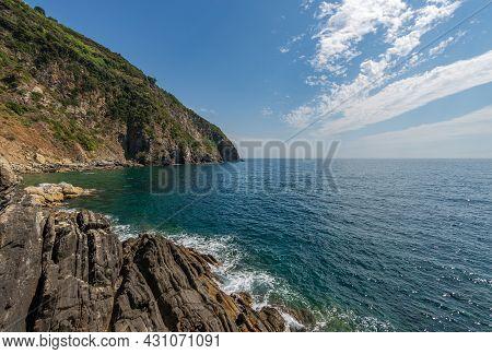 Coast And Seascape (ligurian Sea) In Front Of The Small Riomaggiore Village. Cinque Terre, National
