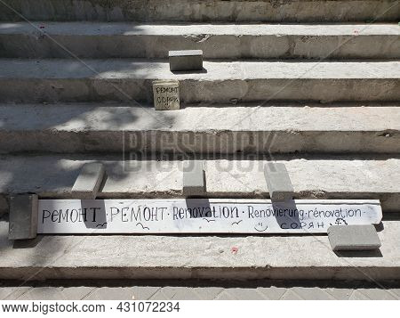 Stairs Renovation. Construction Background. Cement Steps With Bricks And Text On Plate - Renovation,