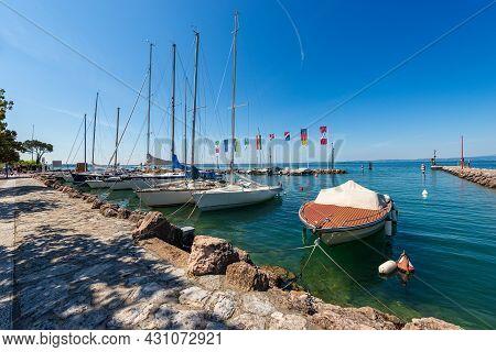 Small Port Of Cisano Village, Tourist Resort On The Coast Of Lake Garda (lago Di Garda). Bardolino M