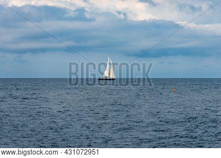 One Sailing Boat On The Horizon On The Mediterranean Sea, Cinque Terre, Liguria, La Spezia, Italy, E