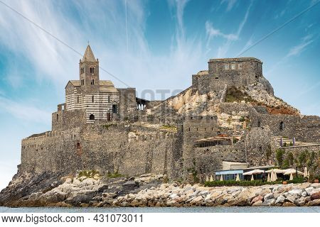 Headland In Portovenere Or Porto Venere With The Ancient Medieval Church Of San Pietro (st. Peter, 1