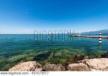 Lake Garda (lago Di Garda) In Front Of The Small Port Of Cisano Di Bardolino. Tourist Resort In Vero