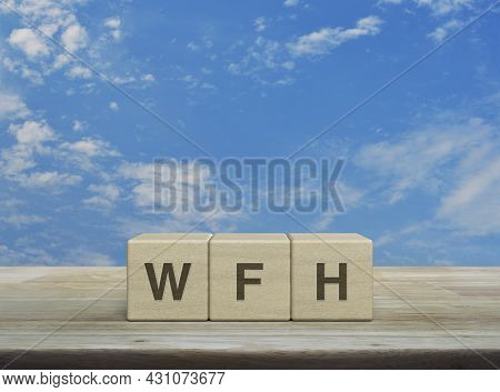 Wfh Letter On Block Cubes On Wooden Table Over Blue Sky With White Clouds, Business Work From Home C