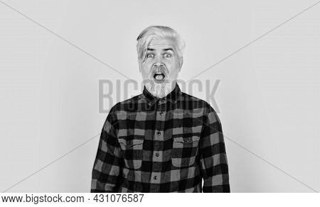 What A Surprise. Mature Hipster Dyed Beard. Hairdresser And Barbershop. Brutal Male Blonde Hair Port