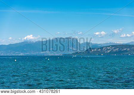 Lake Garda (lago Di Garda) And Italian Alps, Mountain Peak Of Monte Pizzocolo, Adamello And Brenta D