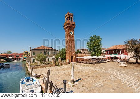 The Ancient Civic Tower Or Clock Tower In Murano Island In Medieval Style. Campo Santo Stefano (sain