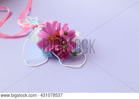 The Concept Of Congratulatory Events During The Pandemic. A Bouquet Of Pink Flowers Decorated With P