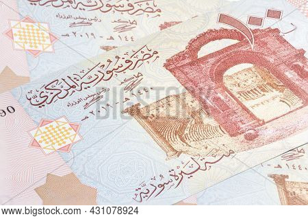 Syrian Pound Or Lira Banknote. Money Of The Arabic Country. Close Up Detailed Money Background. Bank